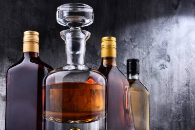 Carafe and bottles of assorted alcoholic beverages.