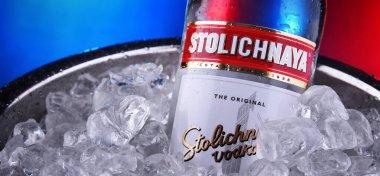 Bottle of Stolichnaya vodka in bucket with crushed ice
