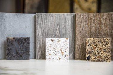 Granite stone samples in front and kitchen door sample.