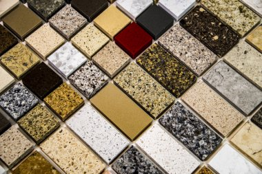 Colorful samples of stone in different sizes used as a kitchen counter tops. Granite, quartz and marble countertops