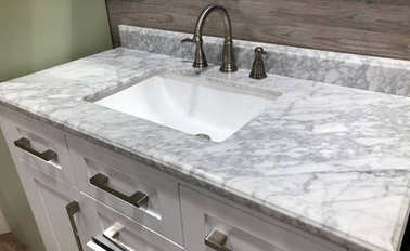 Bathroom vanity with granite counter and white rectangular sink