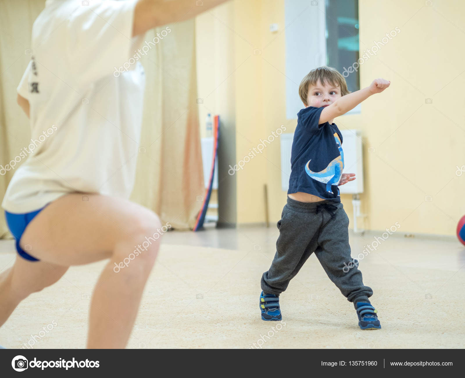 Cute little boy is engaged in martial arts  The baby kicks
