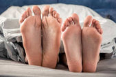 Photo Feet of man and woman
