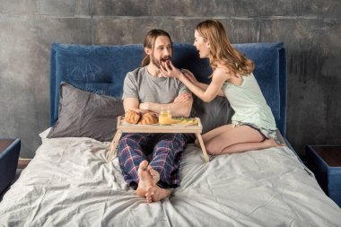 Couple has breakfast in bed