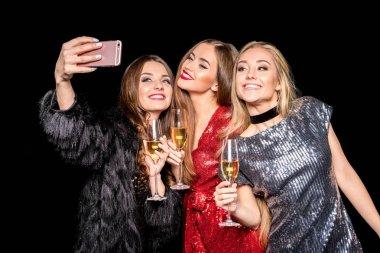 Stylish women taking selfie