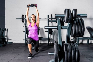 Sportswoman exercising in gym