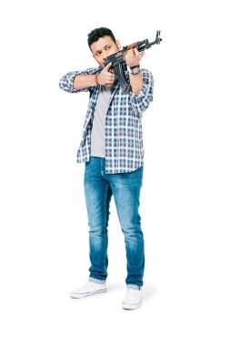 Full length view of young african american man holding rifle and shooting isolated on white stock vector