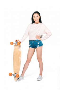 asian girl holding skateboard