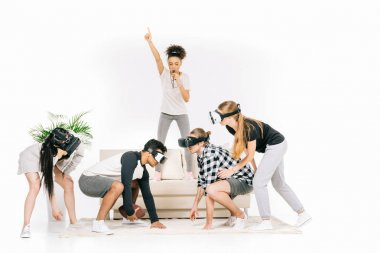 multiethnic friends in virtual reality headsets