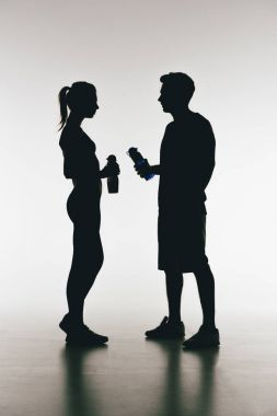 Silhouettes of young fit couple
