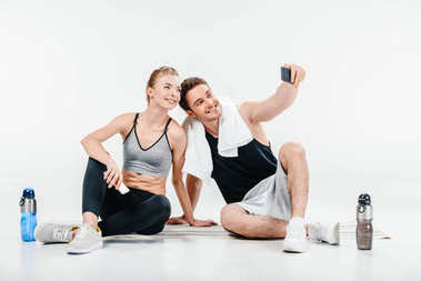 couple taking selfie after training