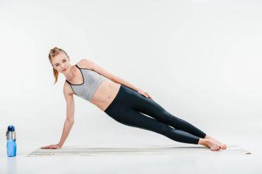 girl doing side plank exercise