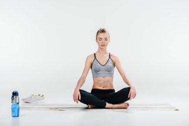 girl meditating in lotus pose