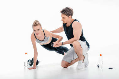 girl doing exercise with trainer