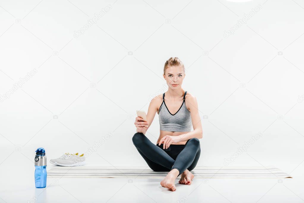 woman using smartphone after workout