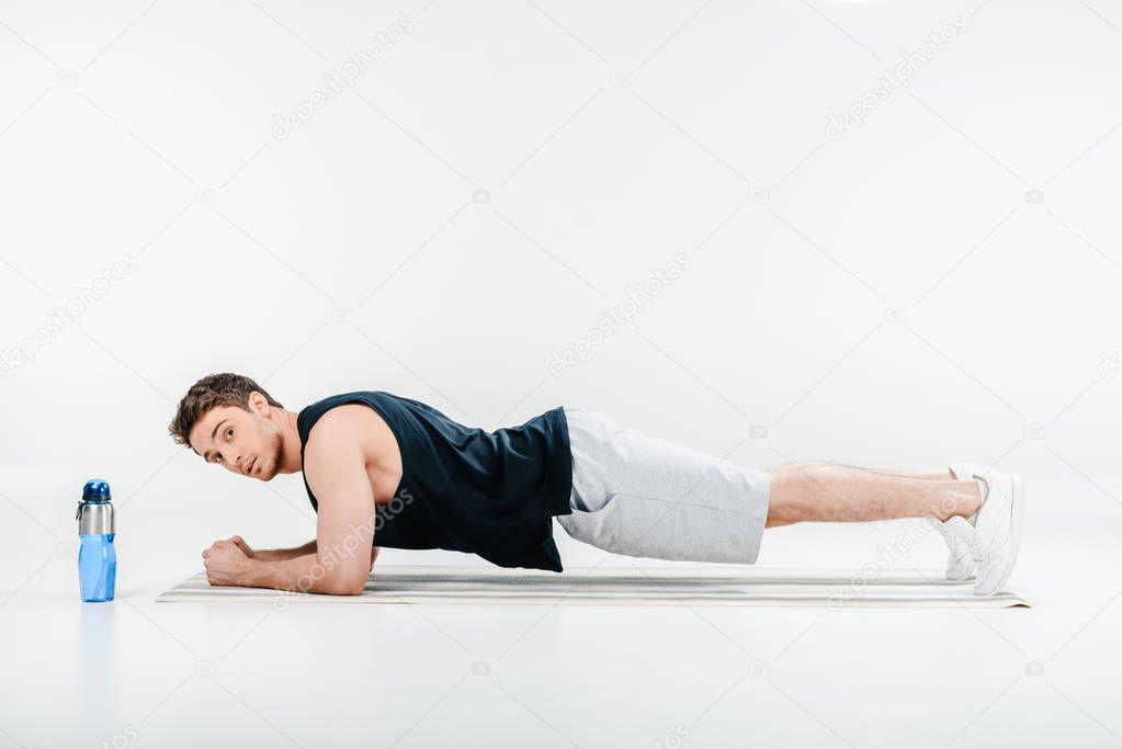 young man standing plank