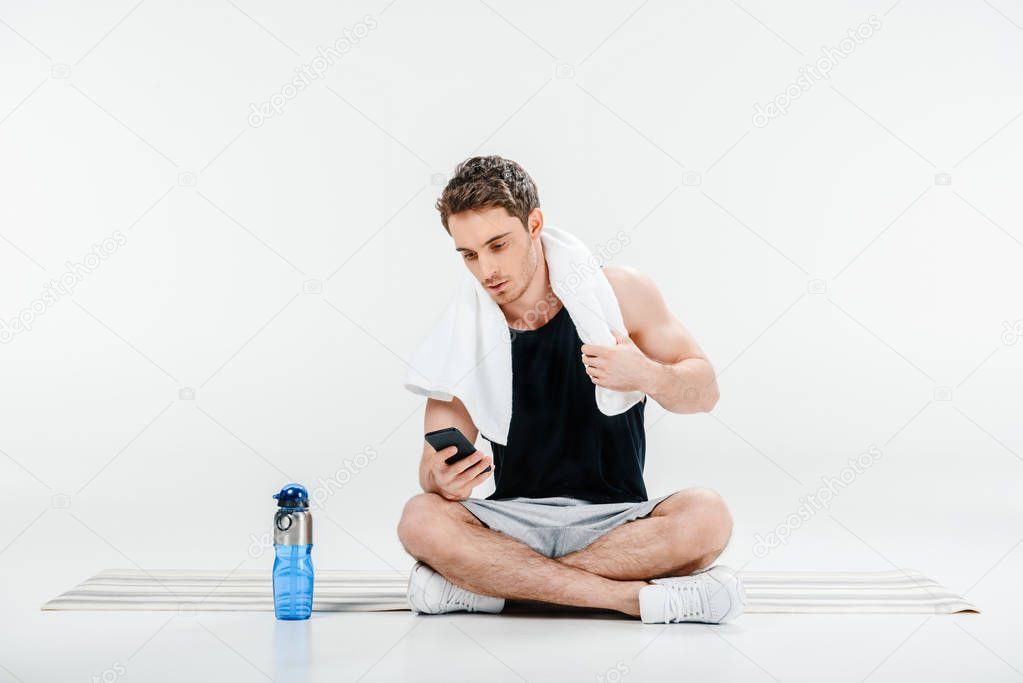 man checking activity in smartphone