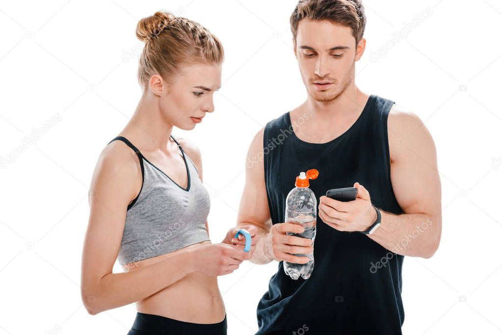 fit couple looking at smartphone