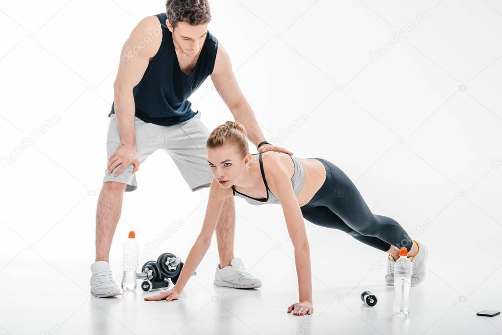 girl doing push ups with trainer