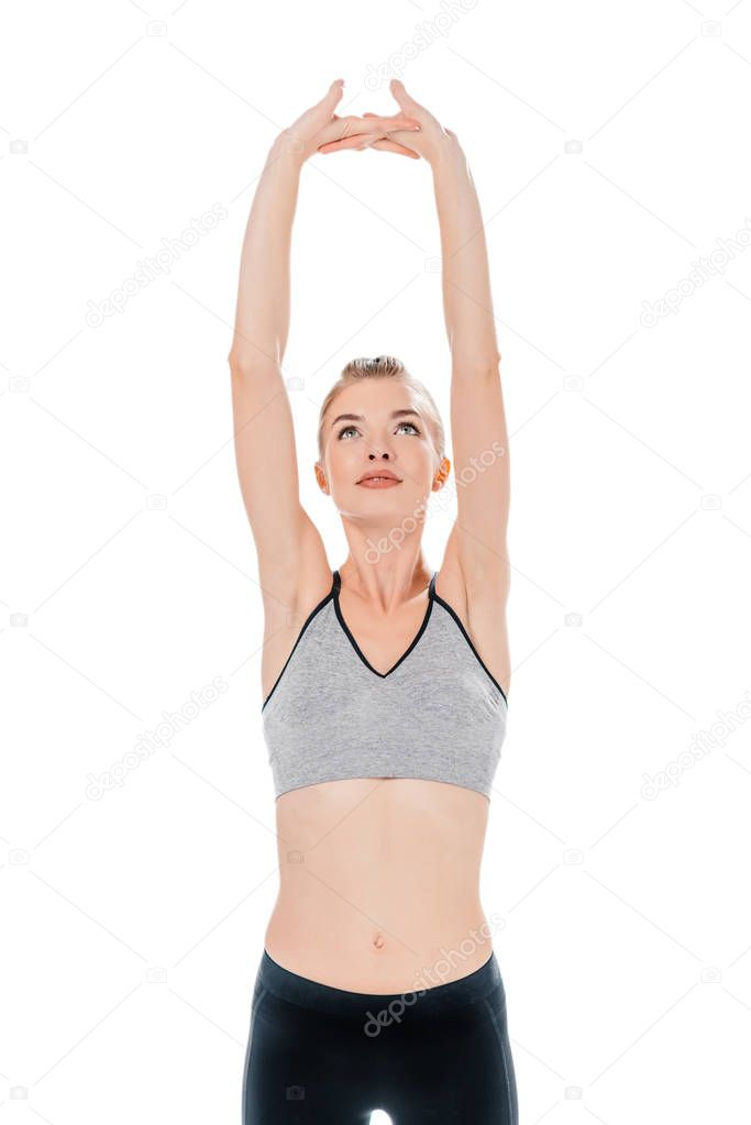 young woman stretching up