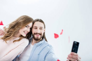 Beautiful happy couple in love taking selfie isolated on white stock vector