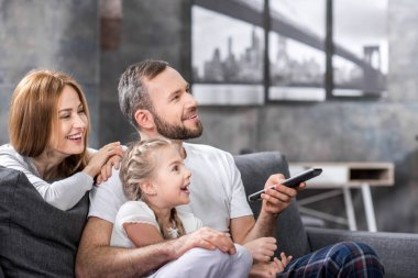 Happy family watching tv