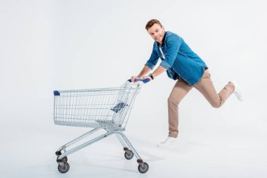 Young man with shopping trolley