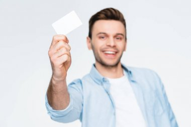 Portrait of smiling man showing credit card and looking to camera, focus on foreground isolated on white stock vector