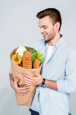 man holding grocery bag