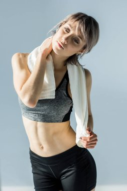 sporty woman with towel