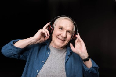 senior man listening music