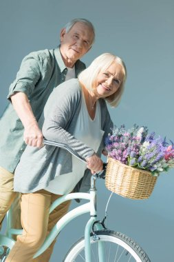 senior couple with bicycle