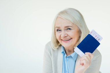 senior woman with passports and tickets