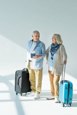 Senior couple with traveling bags