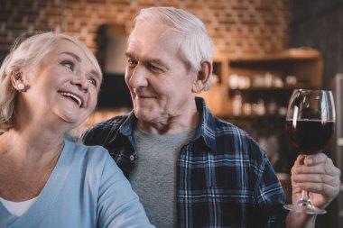 Senior couple with wine