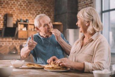 senior couple eating pancakes