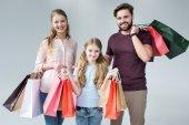 Rodina s nákupními taškami