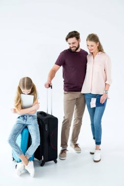 family with traveling bags