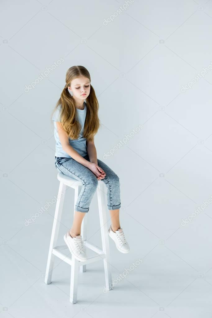 2girl sitting on chair