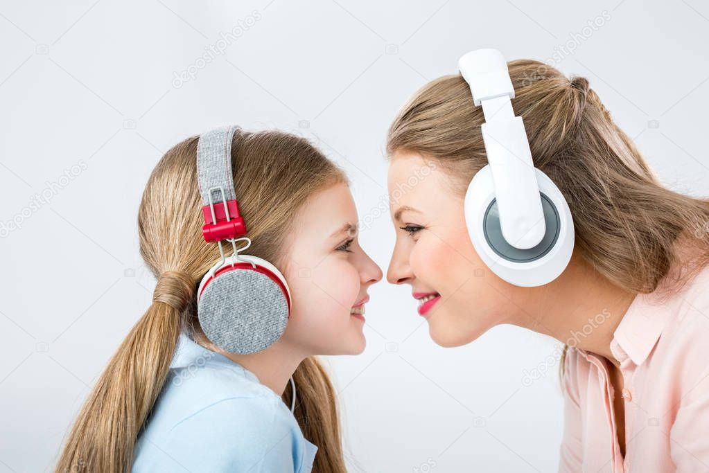 mother and daughter with headphones