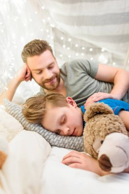 Father and sleeping son