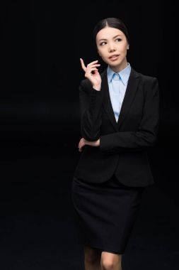 pensive businesswoman in black suit