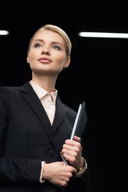businesswoman with notepad in hand
