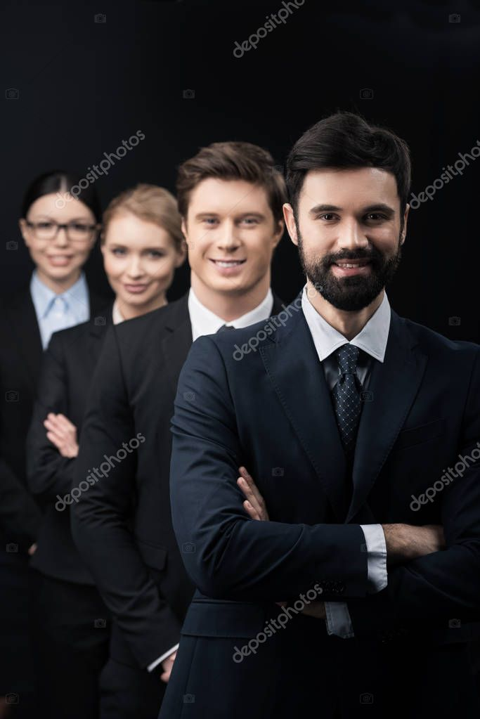 business people standing in row