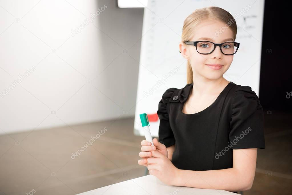 Cute little girl in glasses