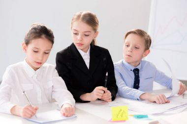 Cute children working with papers