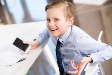 Smiling boy in formal clothes