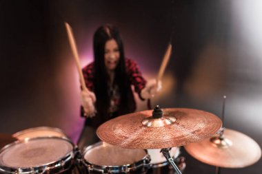 Young musician with drums set