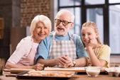 family kneading dough