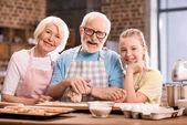 Fotografie family kneading dough